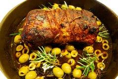 Arrosto di maiale con le olive Fotografie Stock