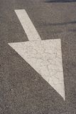 Arrow. On the road pointing downwards stock photography