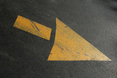 Arrow. A yellow arrow on black top pointing downward, but You can rotate to any direction that you want Stock Photography