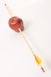 Arrow Through an Apple Stock Images