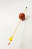 Arrow Through an Apple. Arrow piercing an apple, isolated on white background - full focus Royalty Free Stock Photos