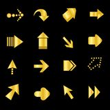 Arrow / Arrows. Collection of different shapes of golden arrows isolated on black Royalty Free Stock Photo
