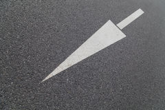 Arrow on asphalt Royalty Free Stock Images