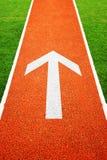 Arrow on athletics running track Royalty Free Stock Photos