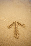 Arrow in beach sand Stock Images