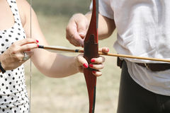 Arrow and bow in hands of an unidentified archer Royalty Free Stock Image