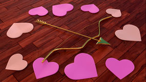 Arrow and bow with heart shapes on wooden floor Stock Photo