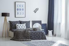 Arrow in bright bedroom interior Stock Photos