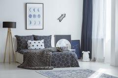 Arrow in bright bedroom interior Stock Photos