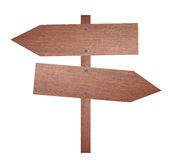 Arrow brown wooden signboard. Royalty Free Stock Images