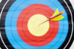 Arrow in bullseye of target (close-up) Royalty Free Stock Images