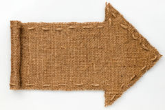 Arrow of burlap with curled edges lies on a white  background, Royalty Free Stock Image