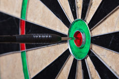 Arrow In The Center Of Darts Board Stock Photo
