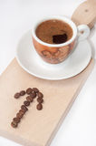 Arrow of coffee beans and cup of coffee Royalty Free Stock Images