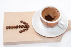 Arrow of coffee beans and cup of coffee Stock Images