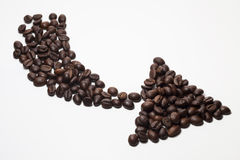 Arrow of coffee beans Stock Images