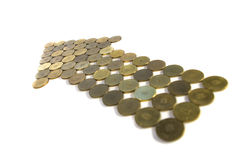 Arrow of coins isolated Royalty Free Stock Photography