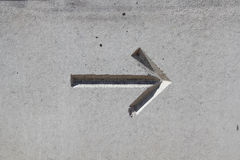 Arrow on concrete Stock Photo