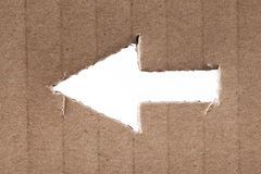 Arrow cut into cardboard Royalty Free Stock Photography