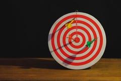 Arrow on dart board paint light stock images