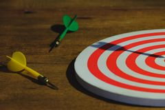 Arrow on dart board paint light stock image