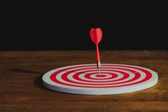 Arrow on dart board paint light royalty free stock photos