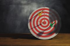 Arrow on dart board paint light royalty free stock images