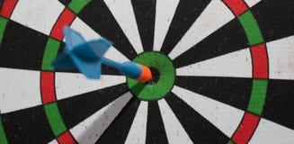 Arrow dart hitting the center of the target Royalty Free Stock Photos