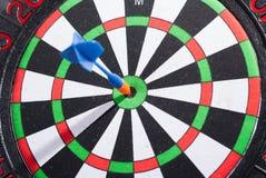 Arrow dart hitting the center of the target Stock Image