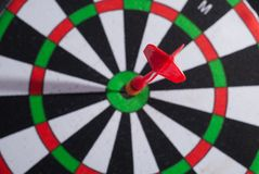 Arrow dart hitting the center of the target Royalty Free Stock Image