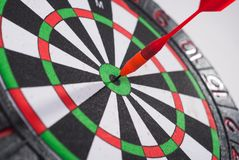 Arrow dart hitting the center of the target Royalty Free Stock Photo