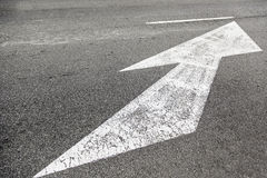Arrow direction on asphalt Stock Photography