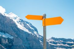 Direction sign with snowy mountain. Arrow direction sign with snowy mountain stock photos
