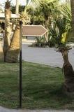 Arrow direction among tropical trees. Stock Photo