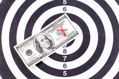 ARrow and Dolar on Dart Board Stock Photography
