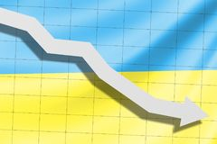 The arrow falls on the background of the Ukraine flag stock photo
