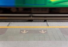 Arrow on floor at sky train Stock Image