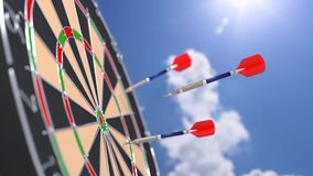 Arrow flying towards a bulls eye of a dart board Royalty Free Stock Image