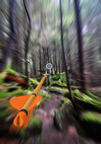 Arrow in focus flying past trees to an archery target in the background, part photo, part 3D rendering Stock Photos