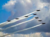 Low pass of formation of PZL-130 Orlik aircraft. Arrow formation consisted of 8 turboprop training aircraft during Radom Air Show in Poland. Aerobatic team Royalty Free Stock Photos