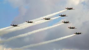 Low pass of formation of PZL-130 Orlik aircraft. Arrow formation consisted of 8 turboprop training aircraft during Radom Air Show in Poland. Aerobatic team Royalty Free Stock Photography