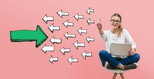 Arrow going in the opposite direction with young woman. Using her laptop vector illustration