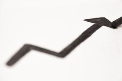Arrow up. An arrow going up, drawn with coal Stock Photo