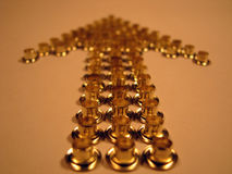 Arrow of gold rivets. Group of gold rivets. Abstract background Stock Photo