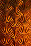 Arrow golden pattern on the wall.  Stock Photography