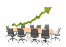 Arrow graph chart over a conference table Stock Photography
