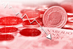 Arrow graph going down and polish currency. In background. All in red color Royalty Free Stock Photos
