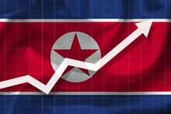 Arrow growth up on the background of the flag NK. White arrow growth up on the background of the flag of the North Korea Stock Photo