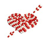 Arrow on heart capsule Stock Photo