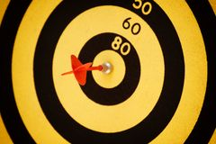 Arrow hit black and yellow Bullseye. Centre Stock Images